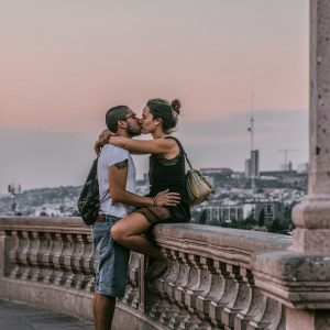 selective-focus-photography-of-man-and-woman-kissing-on-1054072
