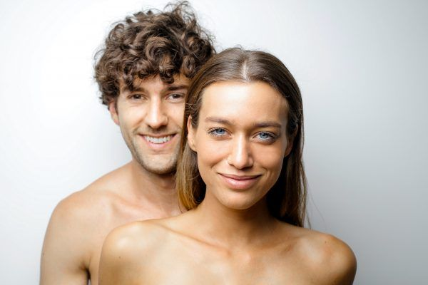 topless-woman-beside-smiling-man-3768705